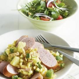 Courgettestamppot uit de wok met ham en ananas