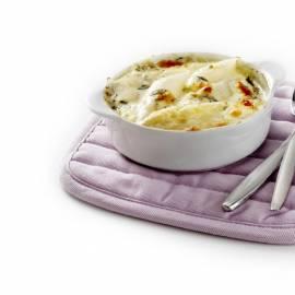 Gegratineerde witte asperges met room en blauwe kaas