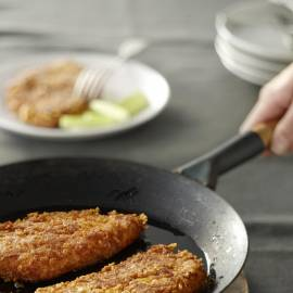 Schnitzel gepaneerd met cheesecornflakes