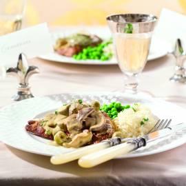 Kalfslapjes met champignons in mosterdsaus