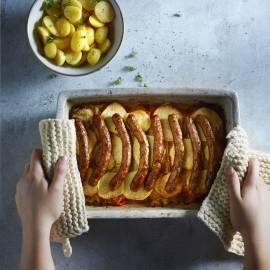 Zuurkoolschotel met paprika, appel en merguezworstjes