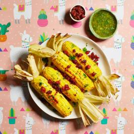 Maiskolven met peterselieboter en chorizo