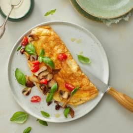 Soufflé-omelet met paddenstoelen