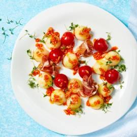 Honingmeloen met prosciutto en tomaatjes