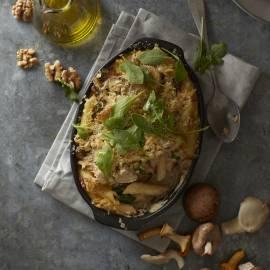 Penne uit de oven met pancetta en paddenstoelen